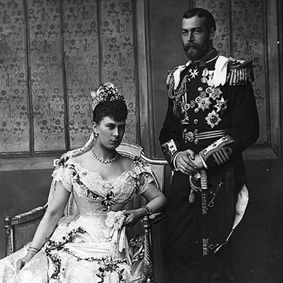 6th July 1893:  King George V (1865 - 1936) on his wedding day with his bride Princess Mary of Teck (1867 - 1953) seated.  (Photo by Hulton Archive/Getty Images)